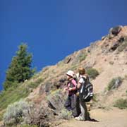 Hikers on trail over Crater Lake